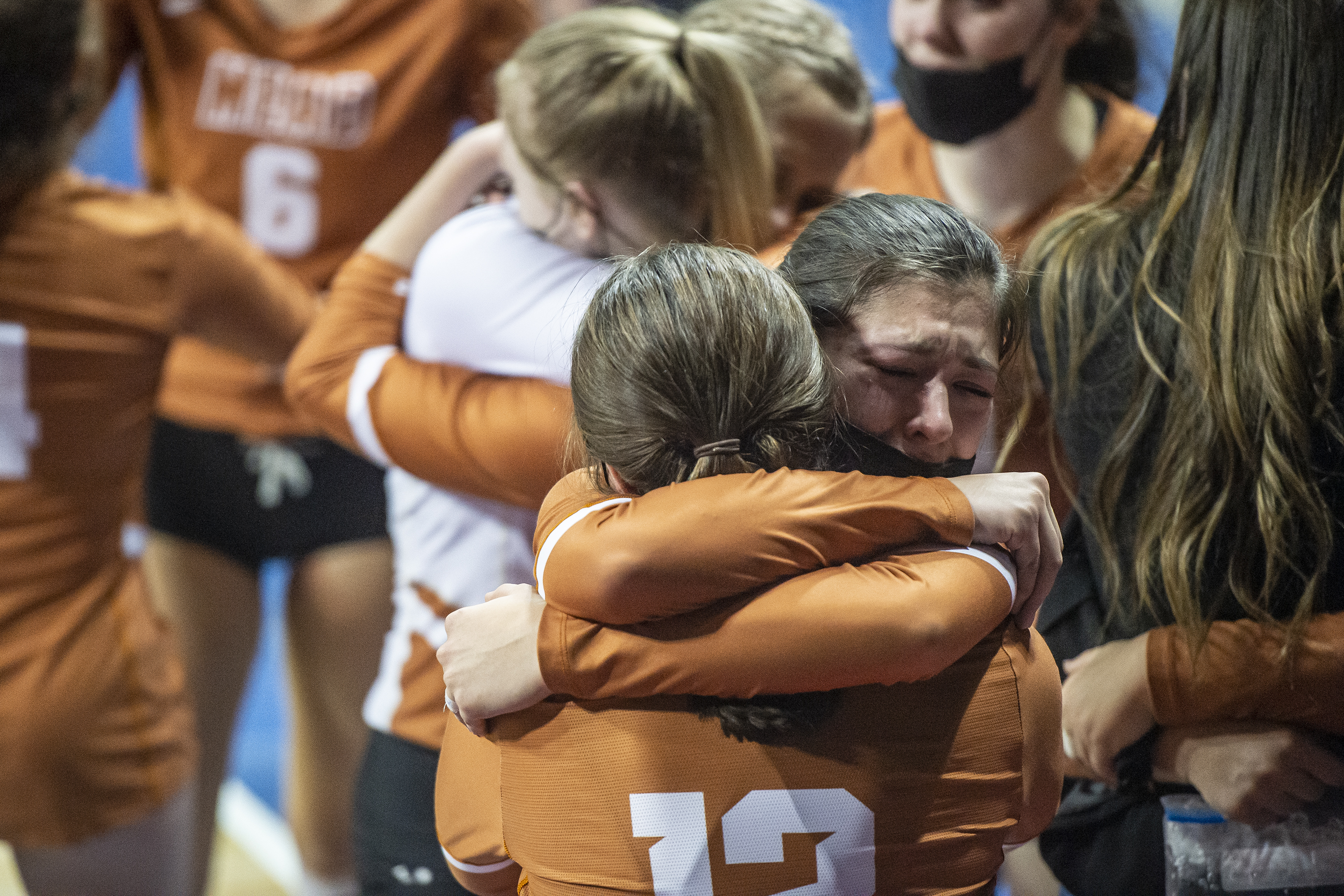 Mead volleyball players hug after being ...